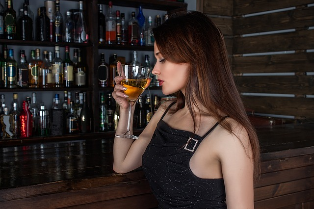 girl drinking in a bar