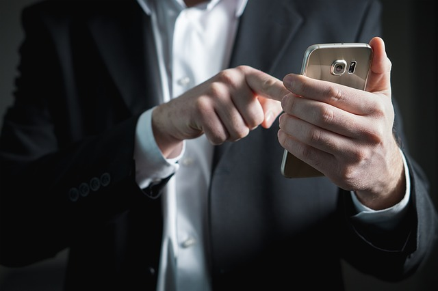 guy pointing at his smart phone