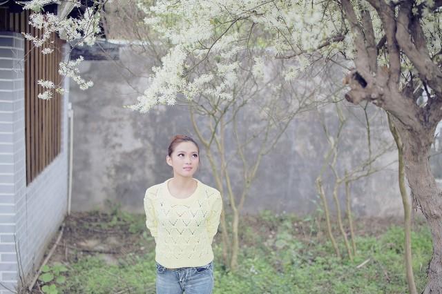 shy girl alone in a garden