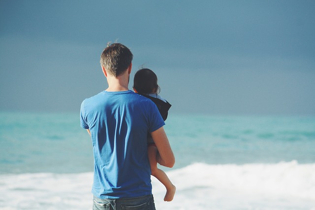 Man and child on the beach