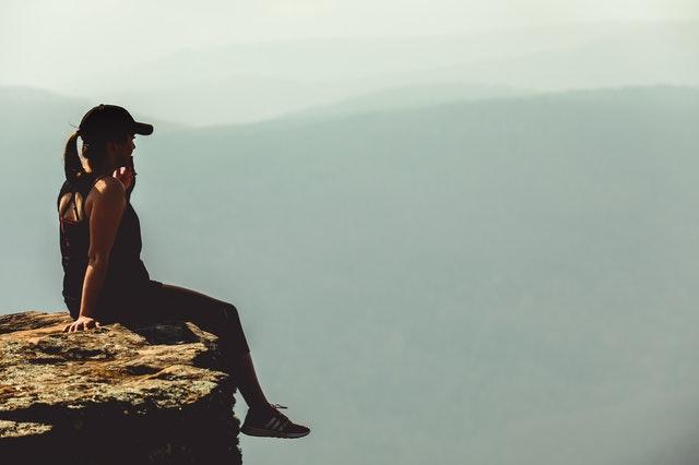 Woman sitting on mountain in Arkansas