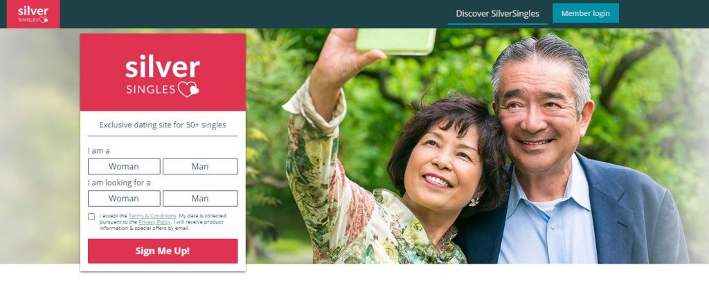Older Asian couple taking a selfie
