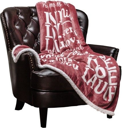 Cute love throw blanket on a black chair