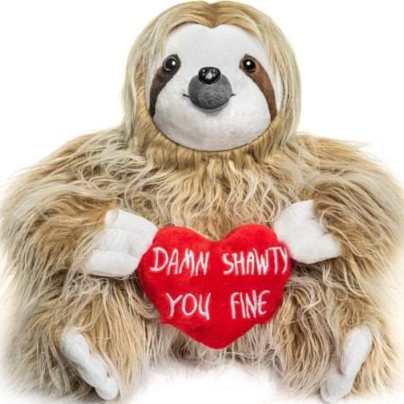 Cute stuffed valentines day sloth holding a heart