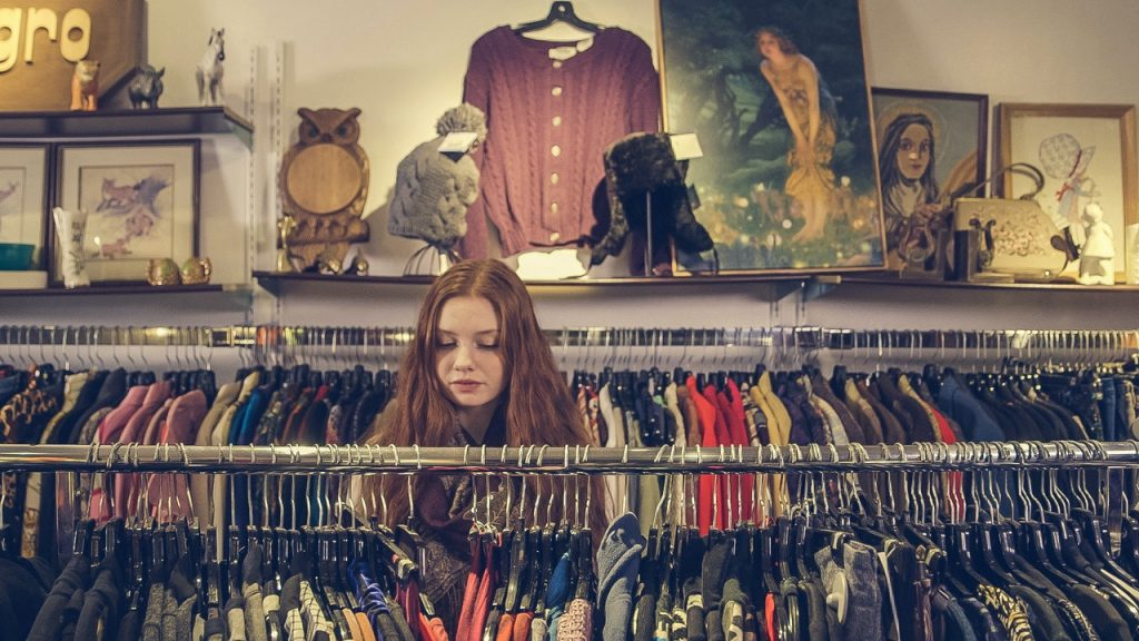 Girl in a store shopping for clothes