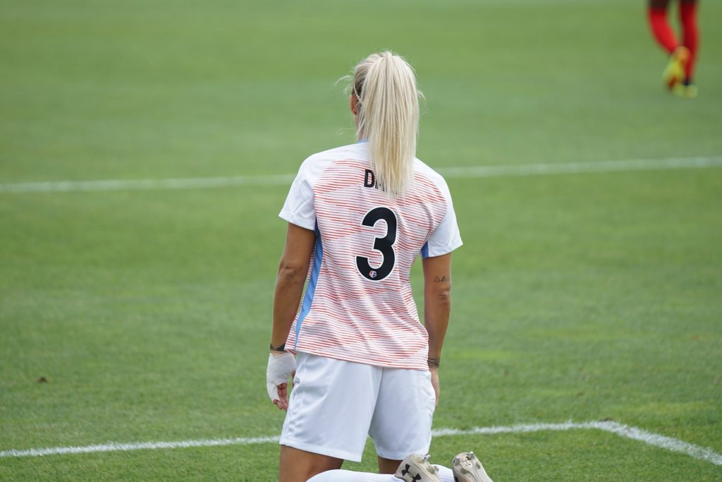 Blonde Girl playing soccer