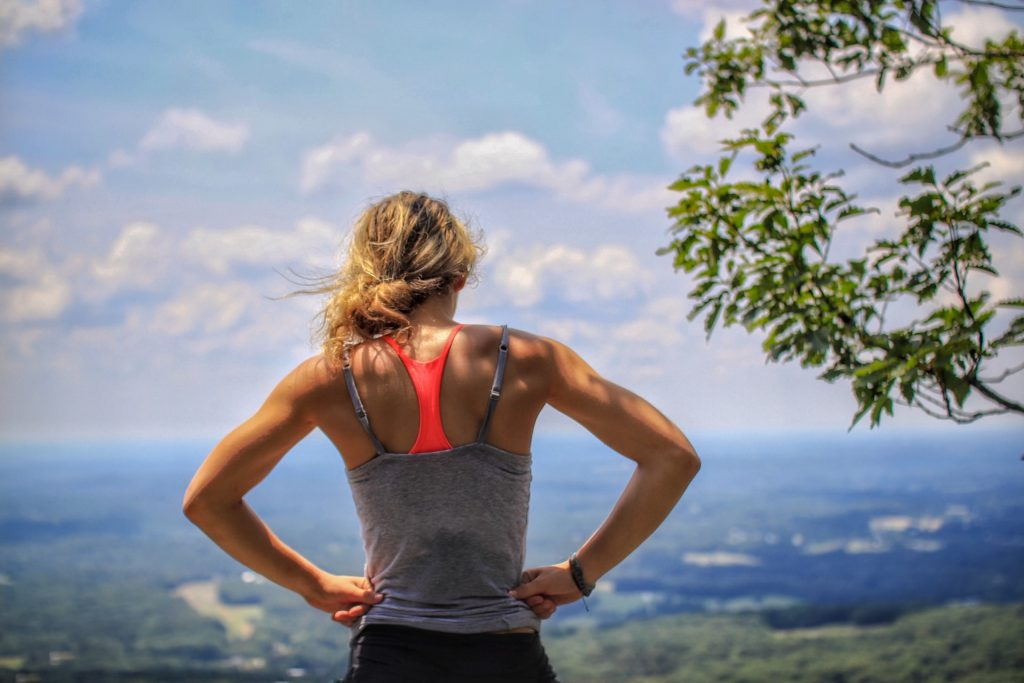 Girl working out hiking overlooking the landscape