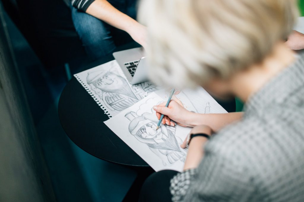 Blonde girl sketching a picture