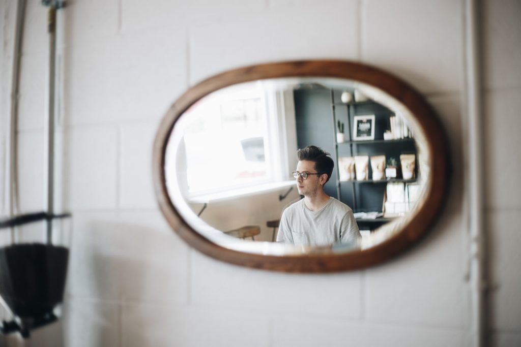 Reflection of man in a mirror