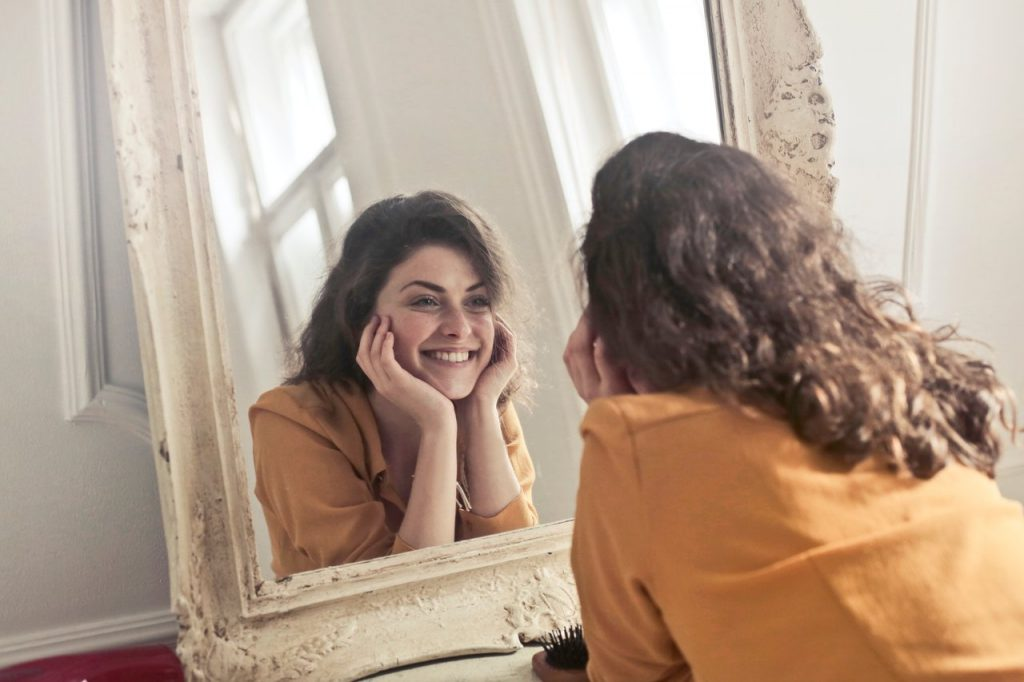 Woman smiling looking in the mirror