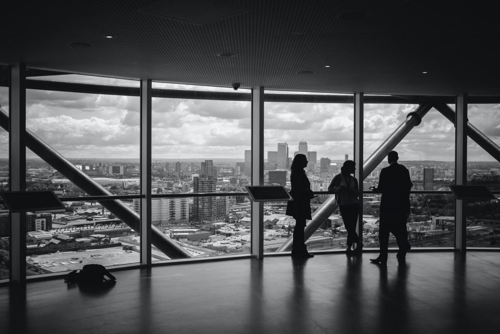 Business People in a high rise overlooking the city