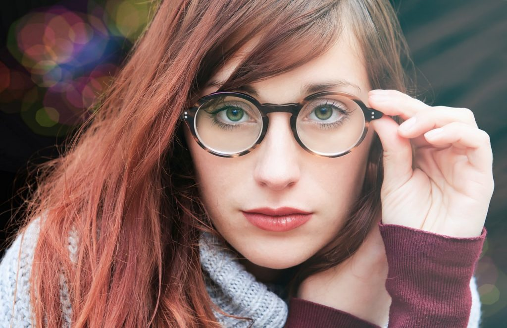 Picture of woman with long red hair wearing eyeglasses