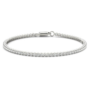 Image of a woman's silver tennis bracelet with three carats of diamonds going around the entire length of the band.