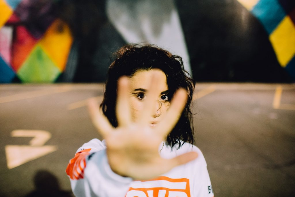 Girl with hand up rejecting
