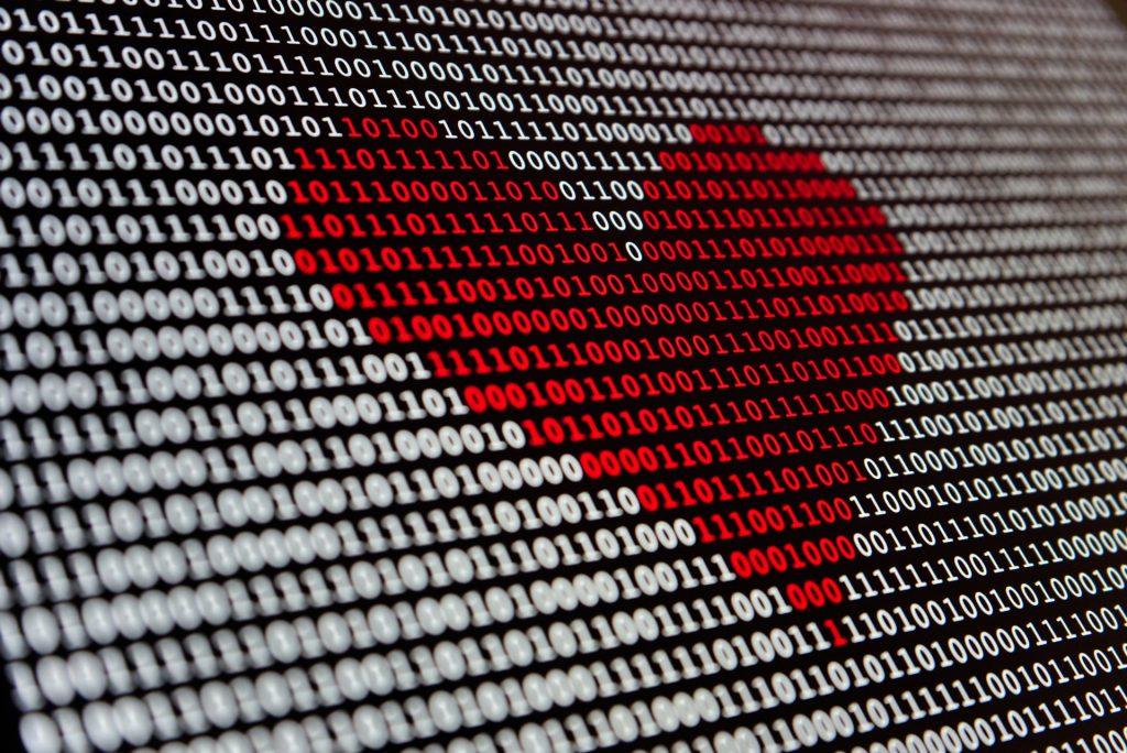 Red heart in binary code
