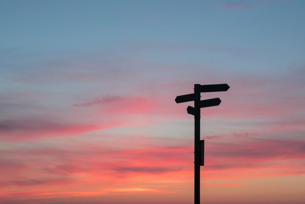 Sign with choices in a sunset