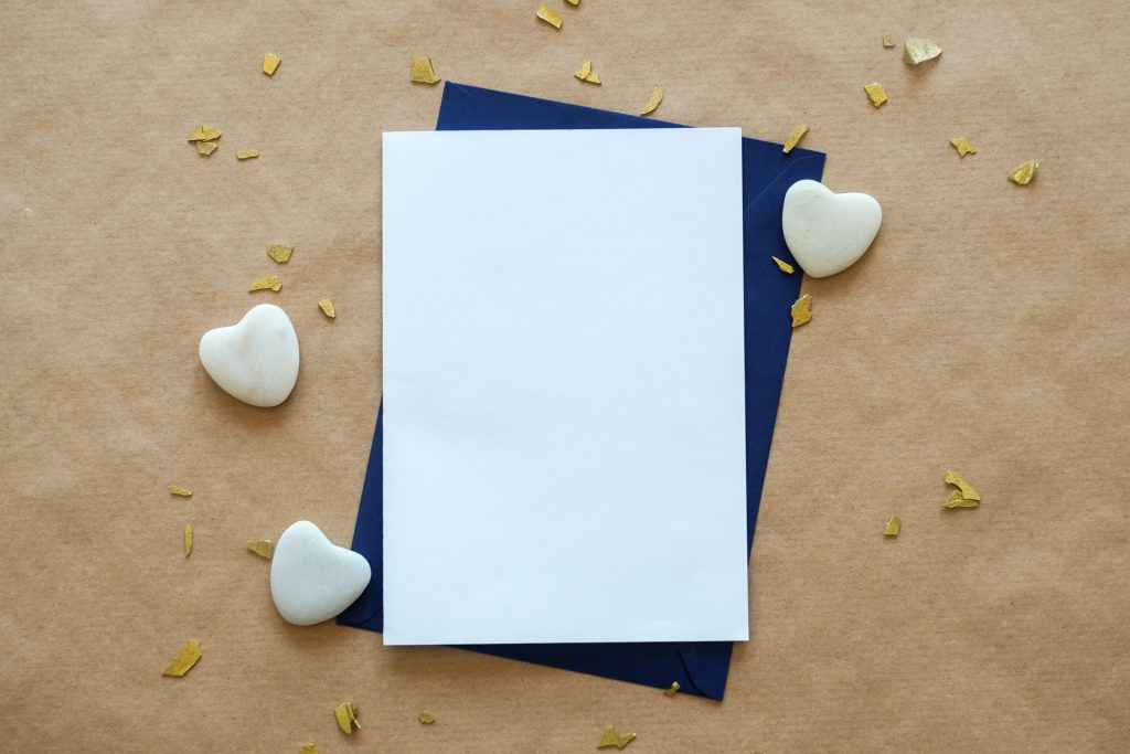Blank Piece of Paper with Hearts Around It