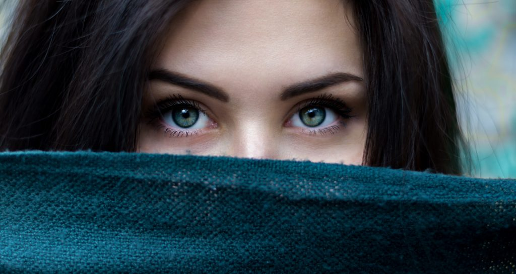 Woman eyes behind blanket
